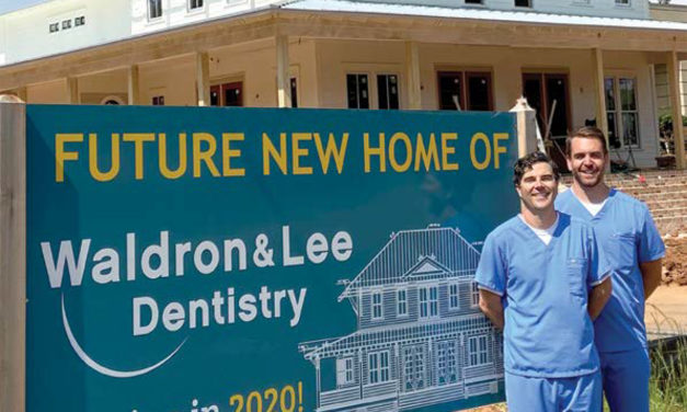 LOOK WHO'S ON OUR FRONT COVER: WALDRON & LEE DENTISTRY
